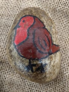 Stone with a robin painted on